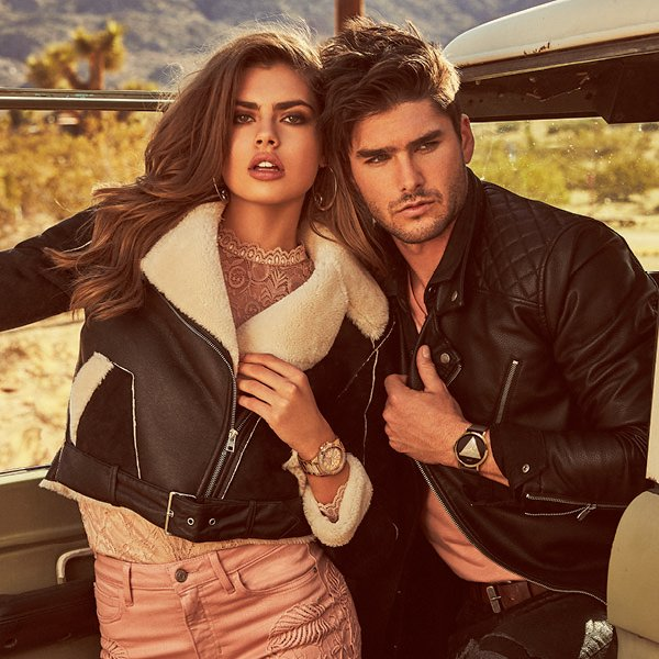 Fashionable man and woman wearing Guess Watches